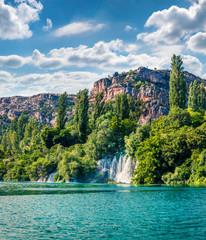 Breathtaking summer view of Krka waterfalls. Sunny morning scene of Krka National Park, Roski Slap location, Croatia, Europe. Beautiful world of Mediterranean countries.