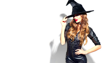 Halloween Sexy Girl wearing witch costume with a hat. Party, Celebrating. Beauty Woman with long...
