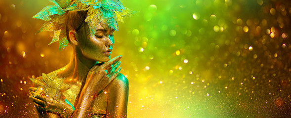 Golden Fashion model woman with bright golden sparkles on skin posing, fantasy flower, portrait of beautiful girl glowing makeup. Art design gold sequins make up. Glitter glowing skin, jewellery, neon Wall mural
