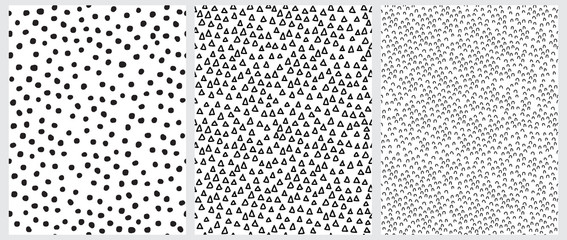 Simple Geometric Irregular Vector Prints Ideal for Fabric, Textile, Wrapping Paper. Abstract Hand Drawn Childish Style Vector Patterns. Black Triangles, Arches and Dots Isolated on a White Background.
