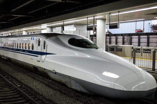 Shinkansen train stopping at station in Tokyo Japan