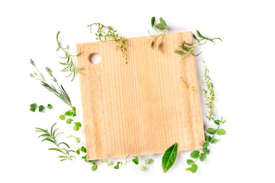 Recipe Design Template. Cutting board with herbs, shot from above on a white background with copy space