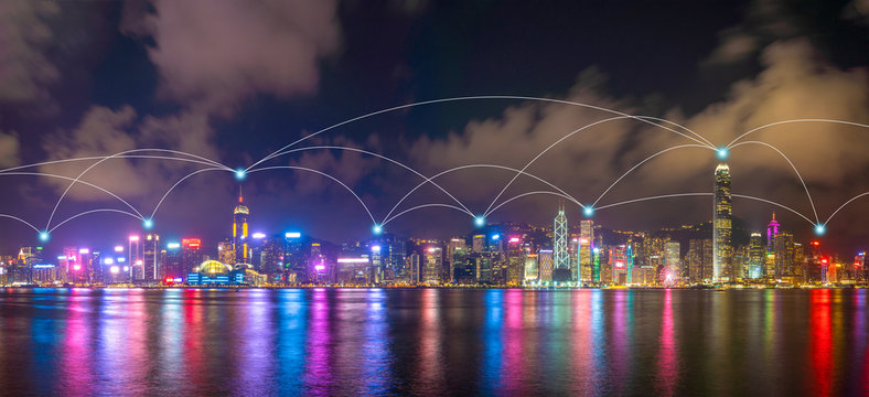 Digital network connection lines of high-rise office buildings, skyscrapers, architectures in financial district. Smart urban city for business and technology concept in Downtown Hong Kong skyline.