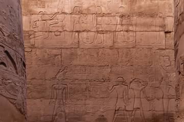 Hieroglyphs on wall of Karnak Temple Complex, famous architectural landmark in Luxor, Egypt.