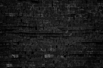 Black brick wall texture for background.