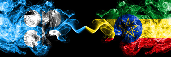 Opec vs Ethiopia, Ethiopian abstract smoky mystic flags placed side by side. Thick colored silky smoke flags of Opec and Ethiopia, Ethiopian