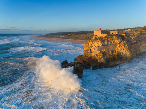 Lighthouse and big waves at in Nazare