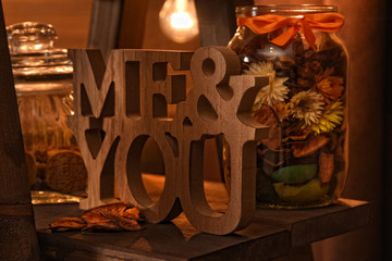 Beautiful vintage autumn composition with wooden me&you sign and dried flowers. Fall season. You and Me love forever concept. Wall mural