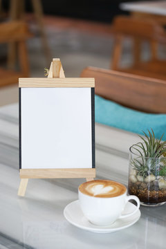 Latte coffee. A cup of coffee with copy space in the wooden frame for your message.
