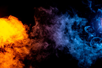 Red and Blue abstract colored smoke on black background