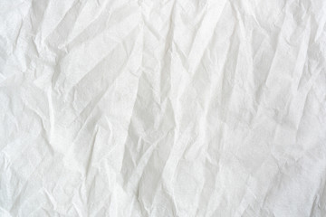 white color creased paper tissue background texture.