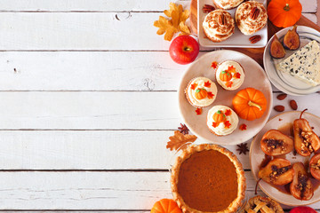 Autumn food side border. Table scene with a selection of pies, appetizers and desserts. Top view over a white wood background. Copy space.