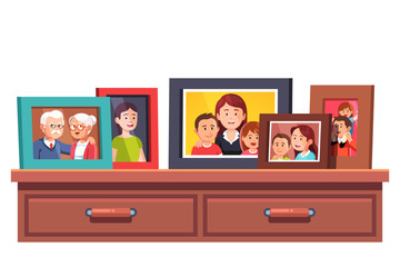 Family relatives photos frames on chest of drawers
