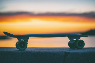 skateboard on the background of the sky at sunset