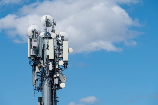 Cellular Base Station With Blue Sky And Clouds
