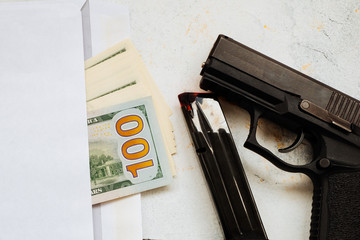 Contract killing and murder for money concept. Bullets on dollar bills as symbol of terrorism, death, suffering