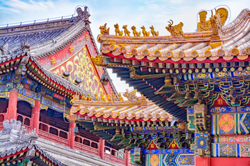Poster Peking Chinese traditional architecture - colorful ornament and statue dragons on roof of Lama Temple in Beijing, China