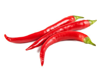 Red oblong peppers on a white background (view from a different angle in the portfolio)