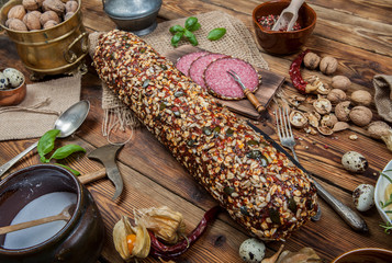 Salami with decoration on a wooden table (view from a different perspective in the portfolio)