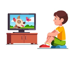 Boy watching film on TV about dog and butterfly