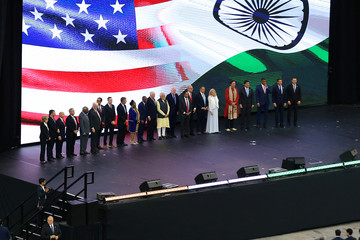 """India's Prime Minister Narendra Modi stands with several United States dignitaries during a """"Howdy, Modi"""" rally at NRG Stadium in Houston"""