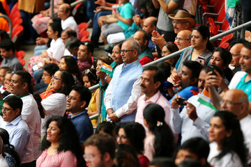 People watch India's Prime Minister Narendra Modi speaking during a rally at NRG Stadium in Houston