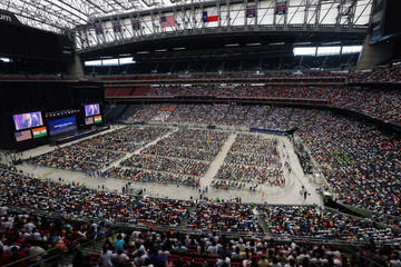 """People watch U.S. President Donald Trump speaking during a """"Howdy, Modi"""" rally celebrating India's Prime Minister Narendra Modi at NRG Stadium in Houston"""