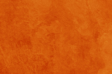 Wall Mural - Solid orange background texture for halloween autumn fall and thanksgiving in old vintage rock or stone wall or rustic painted and distressed metal rust design