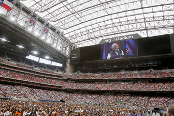 """Indian Prime Minister Modi on the big screen during a """"Howdy, Modi"""" rally at NRG Stadium in Houston"""
