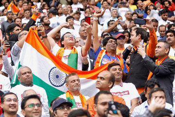 """Supporters hold Indian flags during a """"Howdy, Modi"""" rally celebrating India's Prime Minister Narendra Modi at NRG Stadium in Houston"""