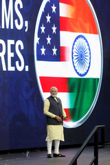 """Indian Prime Minister Narendra Modi takes the stage during a """"Howdy, Modi"""" rally celebration at NRG Stadium in Houston, Texas"""