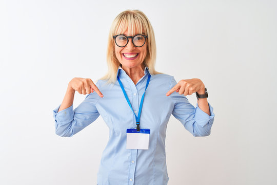 Middle age businesswoman wearing glasses and id card over isolated white background looking confident with smile on face, pointing oneself with fingers proud and happy.