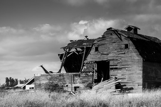 Black and white abandoned barn, aftermath of storm
