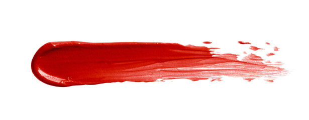 Red lipstick smear smudge swatch isolated on white background. Cosmetic make up texture. Bright red color creme lip stick brushstroke swipe sample