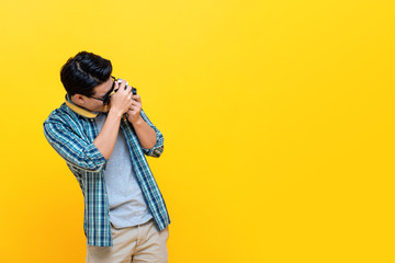 Tourist photographer clicking pictures using camera
