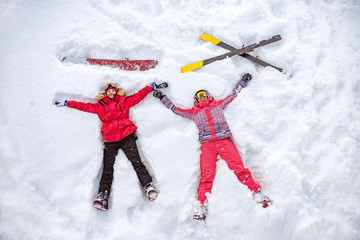 Papiers peints Glisse hiver Aerial photo of skier and snowboarder lying on snow