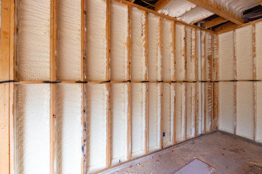 Wall in new home under construction, with spray foam insulation