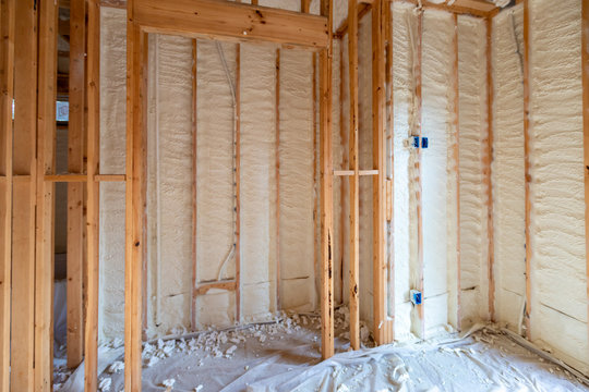 Walls with spray foam insulation in new house construction