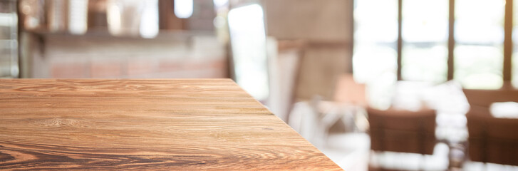 wood table top product display background with blur people in green cafe restaurant.left perspective wooden kitchen counter.Banner mockup presentation for your product online