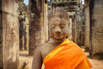 Wall Mural - Closeup view of ancient stone Buddha statue at Bayon temple