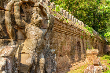 Wall Mural - Ancient stone sculpture at Angkor, Siem Reap, Cambodia