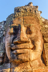 Fototapete - Unusual view of giant stone face of Bayon temple, Angkor