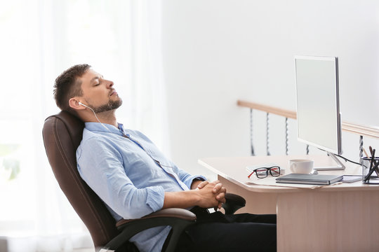 Man having break during work in office