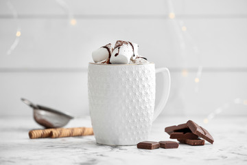 Fotobehang Chocolade Cup of hot chocolate with marshmallows on white table