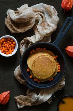 Pumpkin pancakes with sea-buckthorn sauce and berries