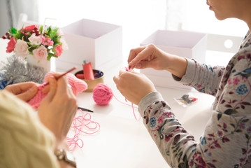 Young attractive girls in a crochet lesson