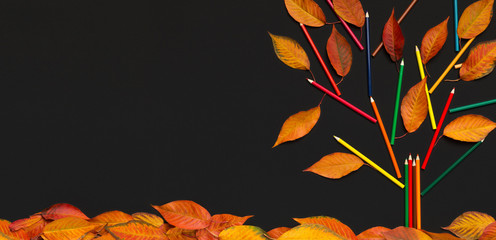 Bright autumn creative tree on background with fallen leaves