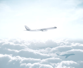 Wall Mural - Big airplane flying over the clouds