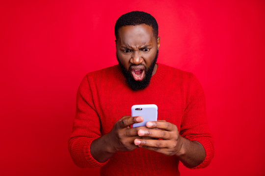 Close-up portrait of his he nice attractive irritated annoyed outraged bearded guy using wireless connection app 5g blog post smm spam messenger isolated over bright vivid shine red background