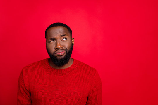 Close-up portrait of his he nice attractive skeptic doubtful bearded guy boyfriend creating plan guessing clue isolated over bright vivid shine red background